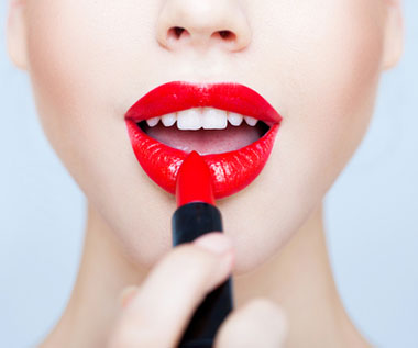 https://www.gurl.com/wp-content/uploads/2013/04/woman-applying-red-lipstick.jpg
